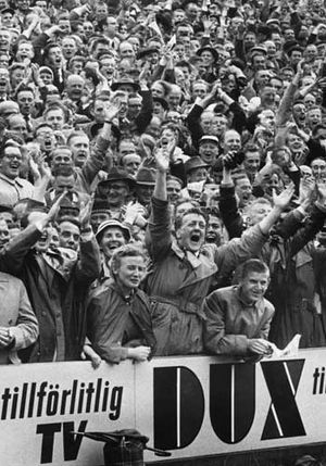English: Enthusiastic folks during the 1958 Wo...