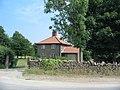 Estate gatehouse at the entrance to Wykeham Lakes - geograph.org.uk - 206178.jpg