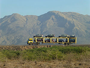 Transport in Ethiopia - An auto transporter passes along a highway in the Lake Beseka region of central Ethiopia
