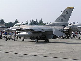 Stabilator - General Dynamics F-16 Fighting Falcon jet fighter parked at an airshow, with stabilators deflected downwards.