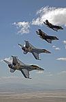 F-35C Lightning IIs of VFA-101 and F-18 Super Hornets in flight near NAS Fallon in September 2015.JPG