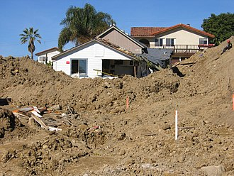 La Conchita, California - Damaged buildings are surrounded by mud in La Conchita. FEMA photo, 01-15-2005.