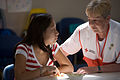 FEMA - 29744 - Red Cross volunteer and shelteree in NJ, photography by Andrea Booher.jpg