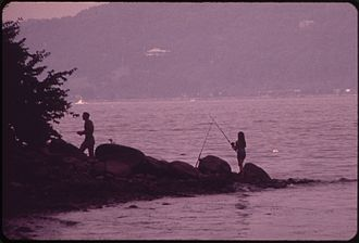 Croton-on-Hudson, New York - A man and woman fishing in Croton Point Park