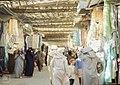 Fes. Garment stalls and ladies in yashmaks (37086050983).jpg