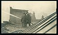 Firemen from Engine Company 32 fighting the Missouri Athletic Club-Boatmen's Bank fire of 9 March 1914 from the roof of the Baumann Safe Company building.jpg