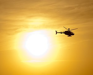 Combat Aviation Brigade, 1st Infantry Division (United States) - An OH-58D Kiowa Warrior helicopter with Task Force Saber, Combat Aviation Brigade, 1st Infantry Division, flies past the setting sun outside Al Asad Air Base, Iraq, May 21, 2010
