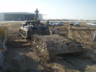 10th Sustainment Brigade - 10th Sustainment Brigade soldiers unearth a tank in Iraq.