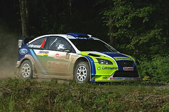Mikko Hirvonen - Hirvonen driving a Ford Focus RS WRC 06 at the 2006 Rally Japan.