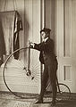 Frances Benjamin Johnston, Self-portrait with false moustache and penny-farthing.jpg
