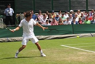Frank Dancevic - Dancevic hitting a groundstroke at Wimbledon 2008.