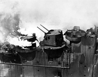 USS Franklin (CV-13) - Aft 5-inch gun turret on fire, 19 March 1945.