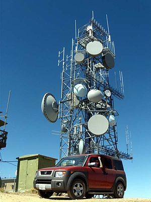 Microwave transmission - Communications tower on Frazier Mountain, Southern California with microwave relay dishes.