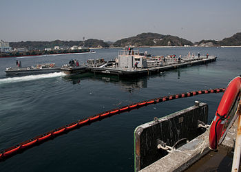 English: US Navy barge transports approx. 1 mi...