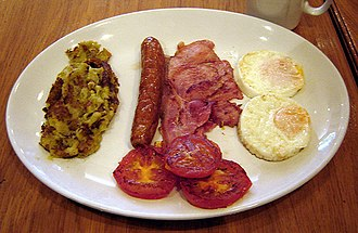 Bubble and squeak - A small portion of bubble and squeak (left), as part of an English breakfast