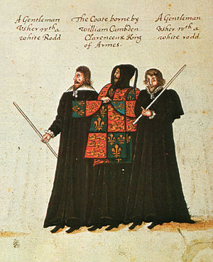 "Gentleman Usher - The funeral procession of Queen Elizabeth I, 1603; William Camden, Clarenceux King of Arms bearing the tabard or ""coate"", between two gentleman ushers. Inscription: ""A Gentleman Usher wth a white Rodd"""