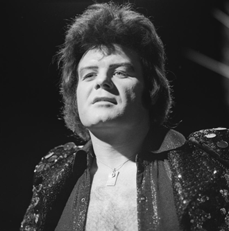 Glitter in 1973, during an appearance on TopPop Gary Glitter - TopPop 1973 3.png