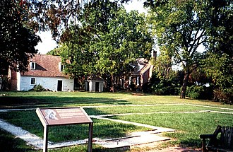 George Washington Birthplace National Monument - Foundation outline (foreground) marking Washington's birthplace, near the memorial house (right rear)
