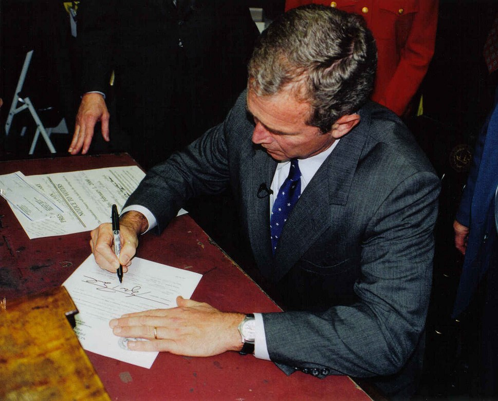 George W. Bush in Concord, New Hampshire signing papers for presidential run