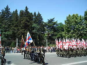 Independence Day (Georgia) - Georgian soldiers with national flags marching on Rustaveli Avenue, Tbilisi, on 26 May 2008.