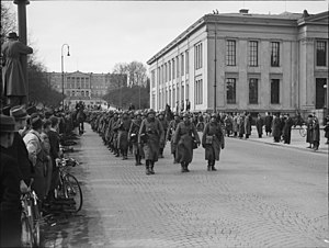 Kai Holst - Norway invaded, German soldiers marching down the main street of Oslo in April 1940