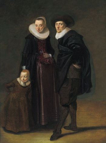 Portrait of a married couple and their child b...