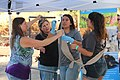 Girl Scouts, biologists and parents glue PVC pipe that will serve as part of the nest base (23224298456).jpg