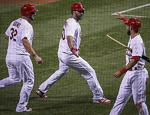2016 St. Louis Cardinals season - Adam Wainwright (middle) flanked by teammates Matt Adams (left) and Matt Carpenter (right) after hitting a three-run home run on May 2, 2016