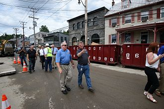 Ellicott City, Maryland - Governor of Maryland Larry Hogan tours Ellicott City, viewing damage left by the 2016 floods, accompanied by county executive Allan Kittleman.