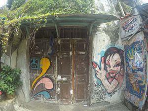 Bandra - Graffiti on a shop door at chapel road Bandra