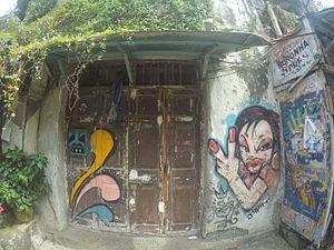 Bandra - Graffiti on a shop door at chapel road Bandra
