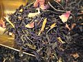 Green tea with rose, jasmine, and sunflower blossoms.jpg