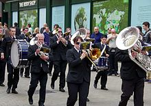 A marching band with a variety of horns and drums.