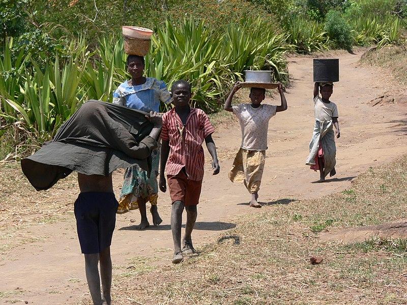 File:Hauling water in Malawi.jpg
