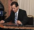Henry Azra playing the Kanun.jpg