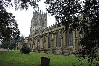 All Saints' Church, Gresford - Seen through yews
