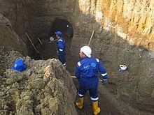 IOM Azerbaijan Masons Specialized en Kahriz Renovation alinome Kankans ĉe Work.jpg
