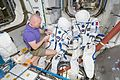 ISS-51 Oleg Novitskiy works on Sokol suits inside the Unity module.jpg