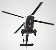 Indian Navy helicopter, seen from below