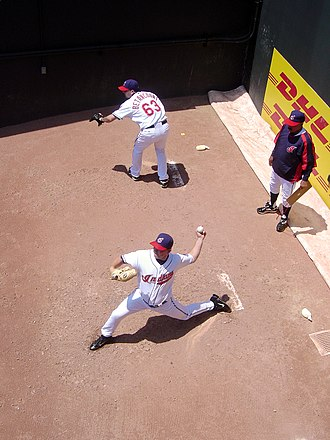 Bullpen - When the game goes on, a relief pitcher warms up in the bullpen. Here Aaron Fultz and Rafael Betancourt warm up in the Cleveland Indians' bullpen behind the Progressive Field fence.