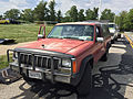 Jeep Comanche with brush guard and hood ornament at work for vendor at 2015 AMO meet.jpg