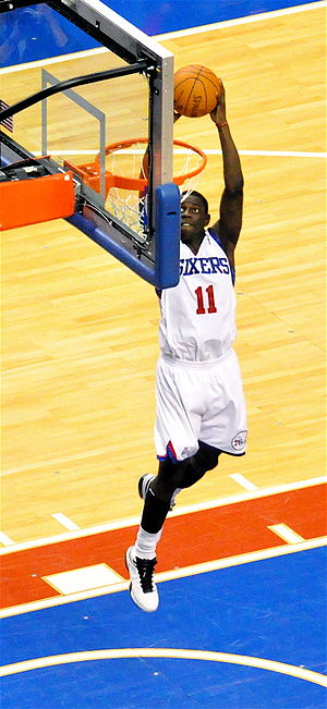 Jrue Holiday of the Philadelphia 76ers dunking...