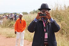 Kamako native taking pictures at ASG arrival (7175918542).jpg