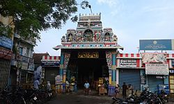 Image of a temple entrance in a busy street