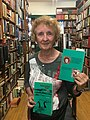 Kathy Martin with her book, Watershed Red.jpg