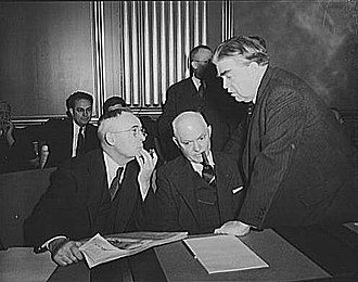 John L. Lewis - John L. Lewis (right), President of the United Mine Workers (UMW), confers with Thomas Kennedy (left), Secretary-Treasurer of the UMW, and Pery Tetlow (center), president of UMW District 17, at the War Labor Board conference of January 15, 1943, discussing the anthracite coal miners' strike.