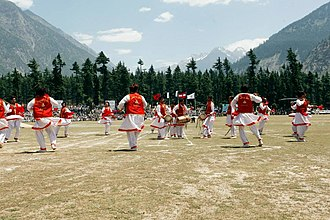 Pashtun culture - A group of dancers performing Khattak dance in Pakistan