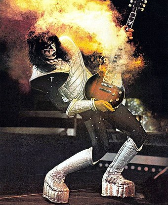 Frehley demonstrates the pyrotechnics that helped make Kiss a live sensation. Kiss - Ace Frehley (1977).jpg