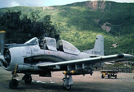 A Royal Lao Air Force (RLAF) North American T-28D-5 Trojan armed trainer loaded with bombs at Long Tieng airfield in Laos, September 1972 T-28D.jpg
