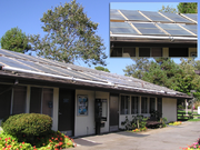 A laundromat in California with flat-plate solar water heating collectors on its roof.